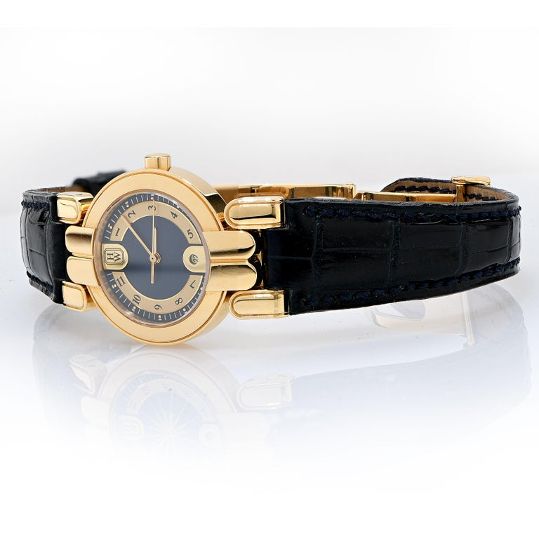 Never been worn, Vintage Harry Winston 27mm Premier Lady's watch in 18 Karat Yellow Gold, 18 karat yellow gold deployment clasp  with two extra straps with 18 karat yellow gold Harry Winston buckles,  Original Box and Papers. This 1990's lady's