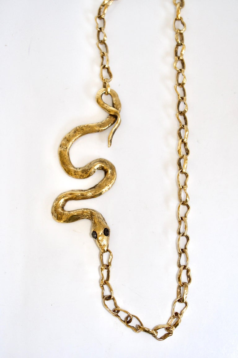 """Snake motif on chain necklace. This necklace is part of a limited edition collaboration between Harumi Klossowska de Rola and the House of Goossens Paris. The chain is 28"""" long and the snake is 5"""".   The NY Times recently wrote an article entitled"""