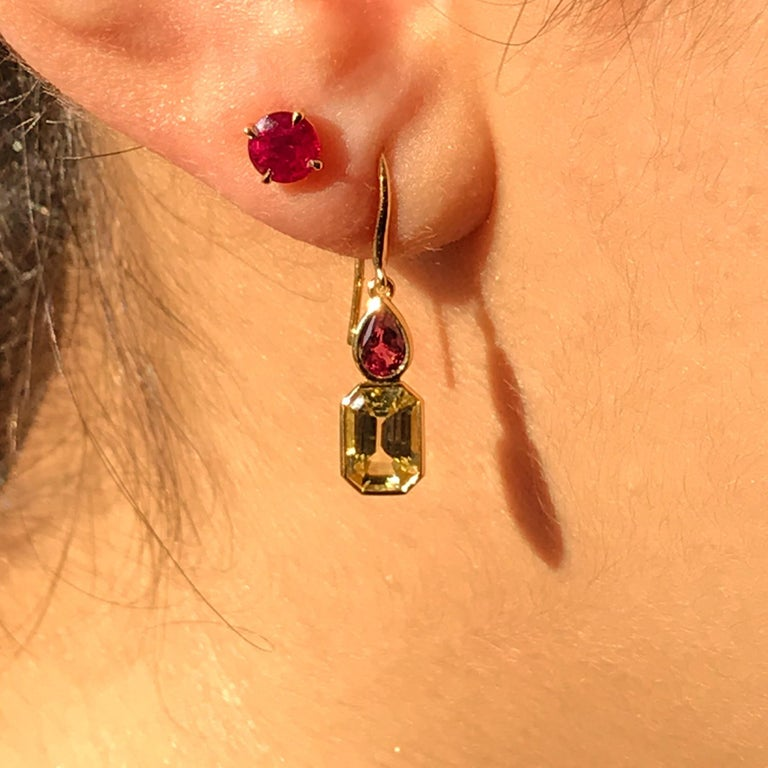 Handmade in the Haruni atelier, these spectacular earrings are truly one of a kind. Emerald Cut Sapphires in an elegant soft yellow colour sitting under a pair of vibrant red pear shape rubies set in a yellow gold frame and hanging from a delicate
