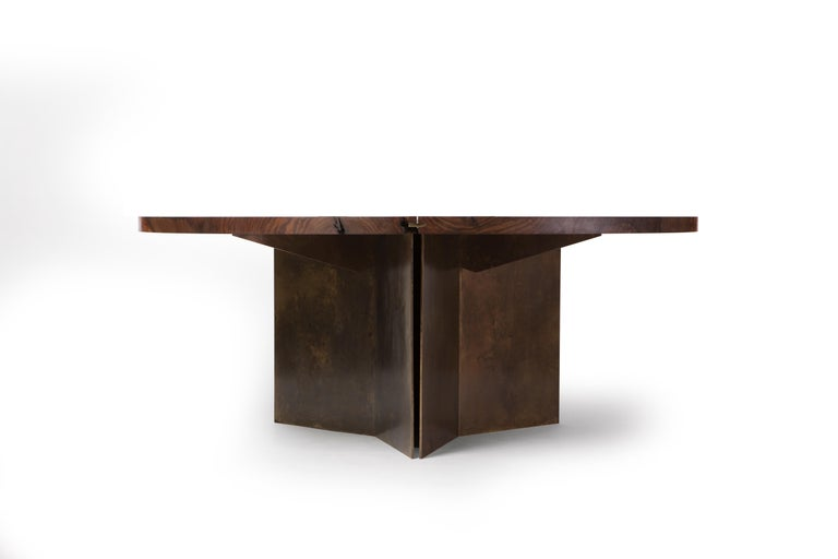 Available in single slab diameters of over six feet, the harvest dining table creates a visual anchor for any dining room or dining nook. Crafted from a single slab of California claro walnut that balances beautiful grain and heavy figure against