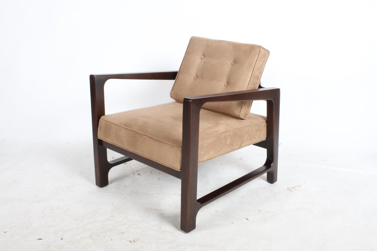 Classic Probber designed lounge chair that evokes the true spirit of the Mid-Century Modern movement. The mahogany frame has been refinished in a medium espresso stain and reupholstered in a tan suede. Probber and Edward Wormley for Dunbar have a
