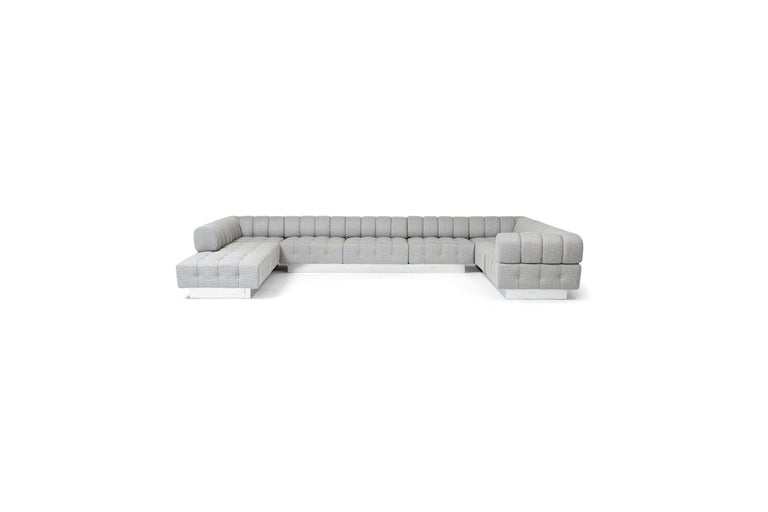 Cubo sofa by Harvey Probber. This large sofa set consists of 3 large sofas, which each contain 3 sections, a total of 9 sections. Fully restored and reupholstered with polished chrome bases.