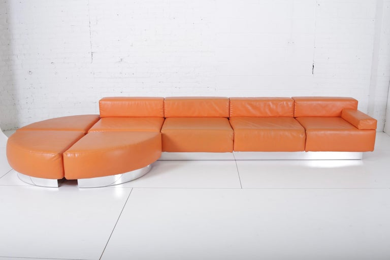 Cubo sofa by Harvey Probber. This large sofa consists of 4 seating sections that fit into 1 chrome base and 3 individual ottomans. Original vinyl shows wear.