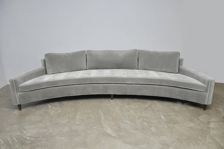 A large curved sofa designed attributed to Harvey Probber. Fully restored. Reupholstered in smoke grey mohair over refinished espresso tone legs.
