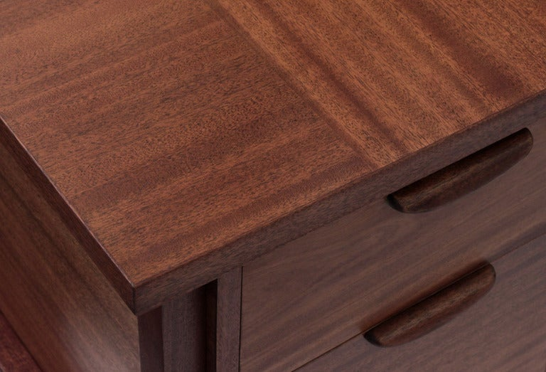 Desk in mahogany with alternating grain top and brass sabots by Harvey Probber, American, 1950s (label in drawer reads