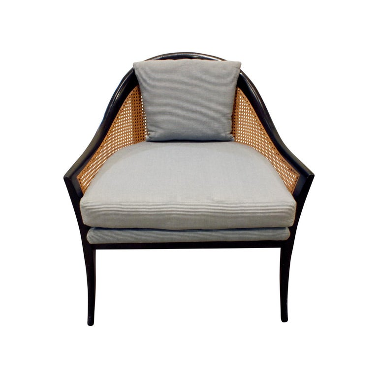 Pair of elegant lounge chairs model No. 915 in mahogany with caned backs and sides with upholstered seats and pillow by Harvey Probber, American, 1950s.