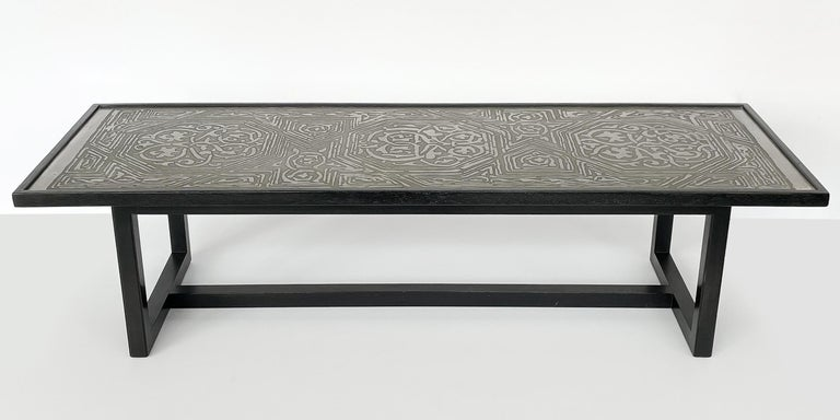 A rare coffee table No. 1322 with etched metal top and black ebonized mahogany frame by Harvey Probber, circa 1950s. Clean lined mahogany frame with black ebonized finish. Possibly refinished at an earlier point in this table's life. The intricate