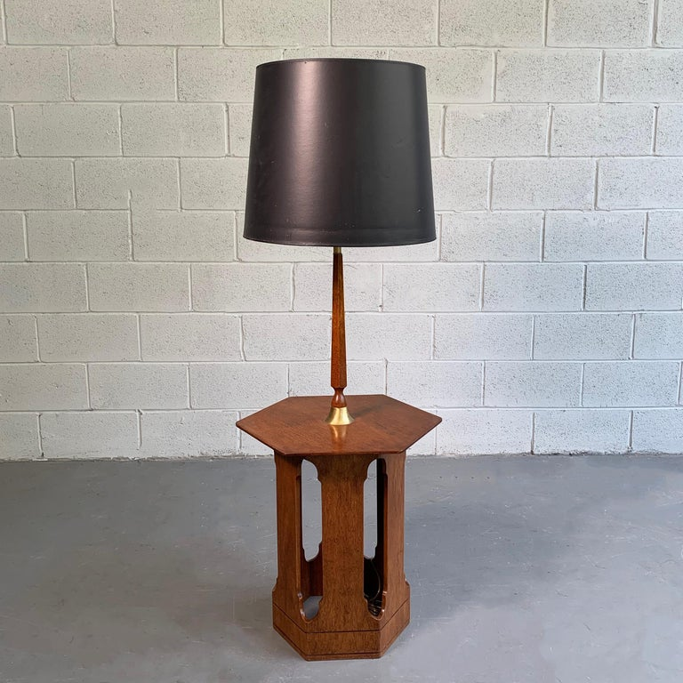 Mid-Century Modern, Moroccan inspired, floor lamp in the style of Harvey Probber features a cut-out, hexagonal table base at 22 inches height with brass accents. The shade shown is not original but can be included.