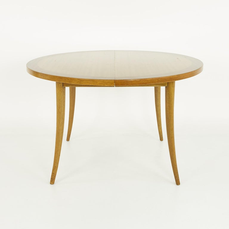 Harvey Probber mid century saber leg extension bleached mahogany dining table  Table measures: 48 wide x 48 deep x 29.5 inches high; the leaves are 16 inches wide, making a maximum width of 80 inches when the leaf is used   ?All pieces of