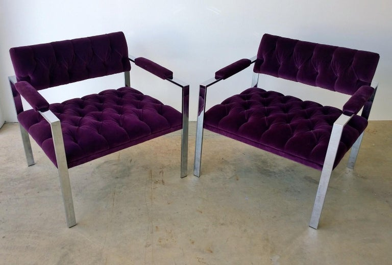 Offered is a pair of Mid-Century Modern Erwin-Lambeth arm or lounge chairs, beautifully button tufted in a brand new eggplant purple cotton velvet upholstery and finished off with a high sheen plated fame. This pair of Erwin-Lambeth arm or lounge