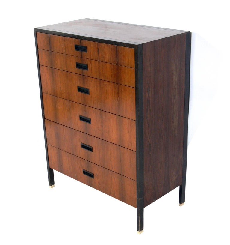 Clean lined rosewood and mahogany chest, designed by Harvey Probber, American, circa 1960s. This chest is being refinished and will look incredible when completed. The priced noted below INCLUDES refinishing. The brass feet have been polished and