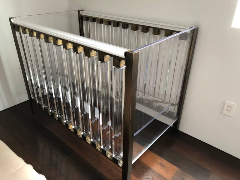 Beautiful and modern baby crib designed by Cain for Cain Modern and manufactured in Los Angeles in 2016. The crib is made out of solid brass and Lucite, the Lucite posts are 2 1/2