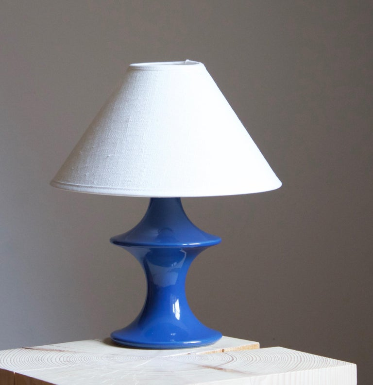 A table lamp produced by Hasle Keramik. In stoneware. Marked.  Stated dimensions exclude lampshade. Height includes socket. Sold without lampshade.  Other ceramicists of the period include Axel Salto, Arne Bang, Carl-Harry Stålhane, and Berndt