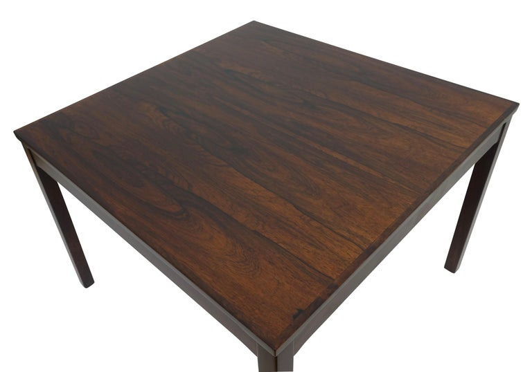 bookmatched rosewood square shape coffee table, having square rosewood legs. Simplicity at its most intriguing. Original Haug Snekkeri label on the underside, as seen in the photo's. Norway, mid to late 20th century.