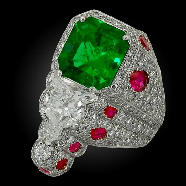 1950's platinum diamond, ruby and emerald ring. approximately 4 cts. of emerald and 2 cts. of diamonds ring size – 4 3/4