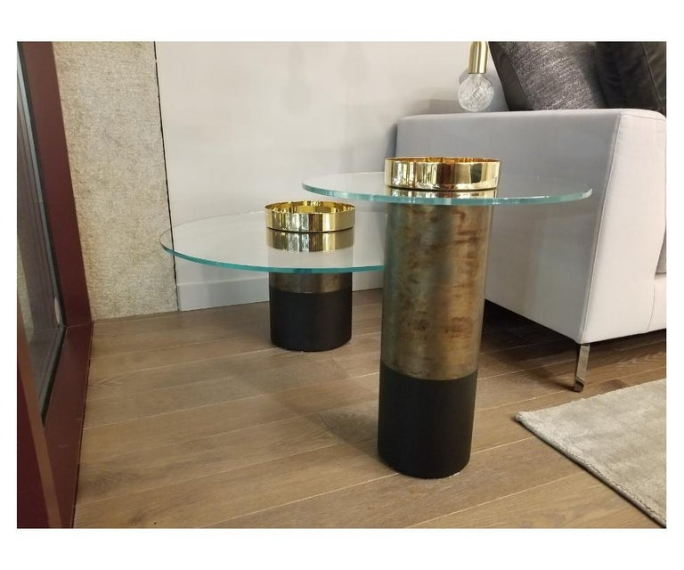 Haumea coffee table designed by Massimo Castagna  Coffee table in 10 mm transparent extra light tempered glass. Black(mod. layer) open pore or rust lacquered wooden base. Bright brass, hand-burnished brass, coppered brass or black chromed metal