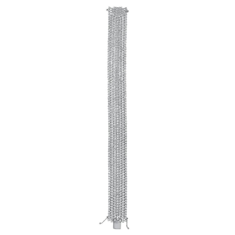 Diamond bracelet comprised of 602 round brilliant diamonds weighing a total of 13 carats, remarkably hand set in this 18K white gold, completely flexible, mesh diamond bracelet. Diamond tennis bracelet total length - 7 inches. Diamond tennis