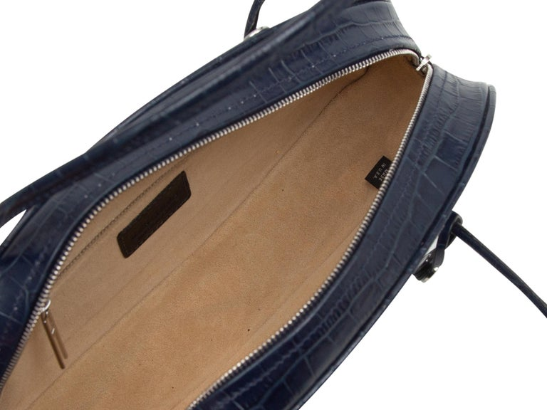 Product details: Navy embossed leather oval handbag by Hayward. Dual rolled top handles. Zip closure at top. 12