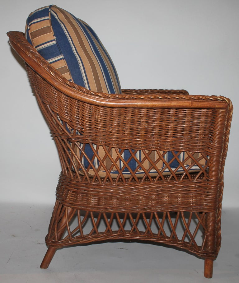 Early 20th century Haywood Wakefield wicker side chair with custom made vintage ticking cushions. The inserts are down and feather fill and can be removed for cleaning.