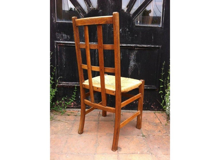 Arts and Crafts Heals, an Arts & Crafts Oak Rush Seat Lattice Back Side Chair For Sale