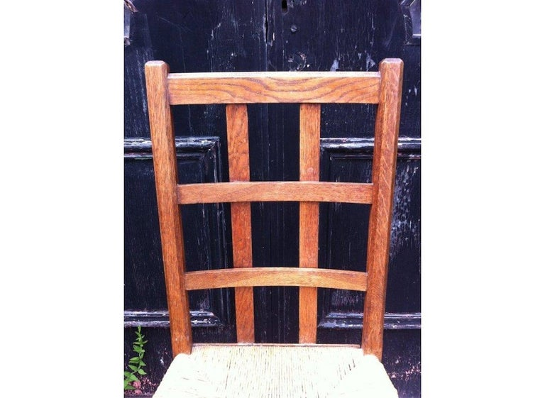 English Heals, an Arts & Crafts Oak Rush Seat Lattice Back Side Chair For Sale