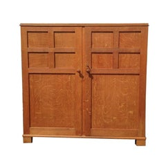 Heals, an Arts & Crafts Oak Tallboy, Compactum Wardrobe or Nursery Chest