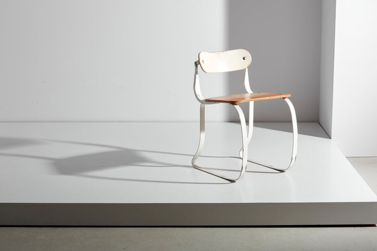 Health chair designed 1938 by Hermann A. Sperlich and produced by Ironrite Inc., Detroit. Important American modernist work chair designed for use with an ironing machine. Painted steel and lacquered plywood. This chair came to the attention of