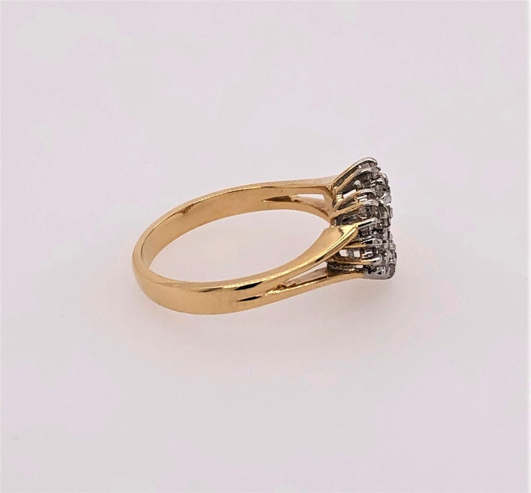 Remind her of your love by giving this diamond covered open heart in fourteen carat yellow gold. In ring size 6-1/4, with thirty prong set round .005 diamonds for a total carat weight of .15 carats. Sizable by your jeweler. In gift box.
