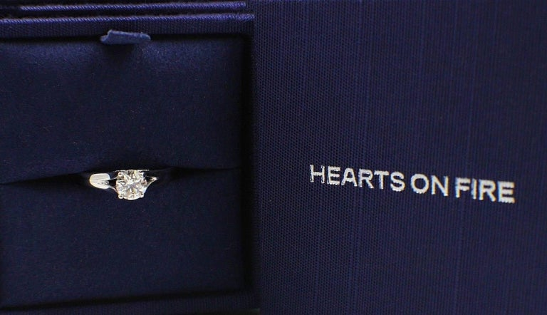 Brand: HEARTS ON FIRE Style:  Seduction Solitaire Diamond Engagement Ring Serial Number: HOF 104599 (Hallmarked inside the ring ) Metal: White Gold 14KT Total Carat Weight:  0.593TCW Diamond Shape: Round Brilliant Ideal Cut Diamond Color: G Clarity: