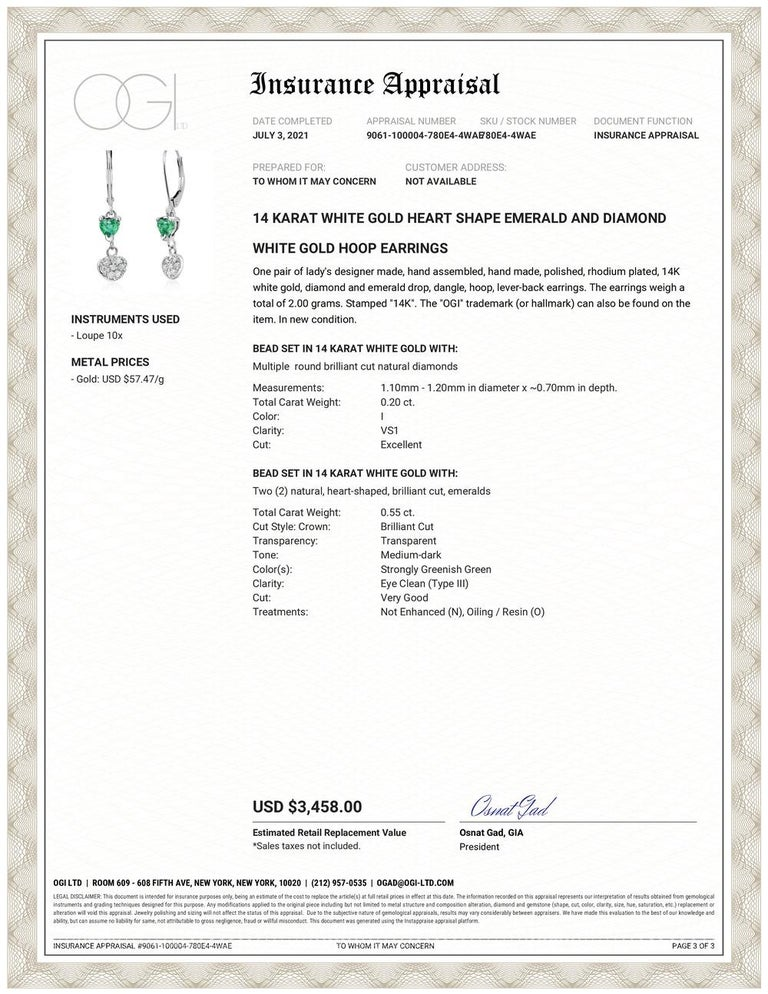 Fourteen karats white gold hoop drop earrings  Diamonds weighing 0.20 carat  Two heart shape emeralds weighing 0.55 carats One of a kind earring New Earrings 14 karat gold wire wrapped hoops  Handmade in the USA Our team of graduate gemologists