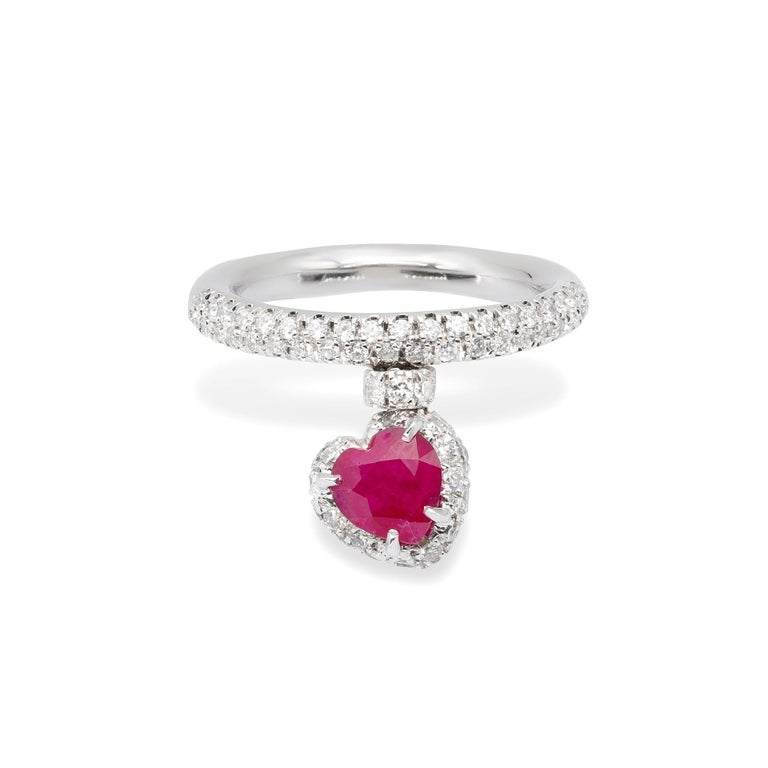 A Ring from d'Avossa True Love Collection in white 18 kt gold with a pendant heart shape natural Ruby 1,58 cts and white diamonds G color, VVS1 clarity 0,79 cts.