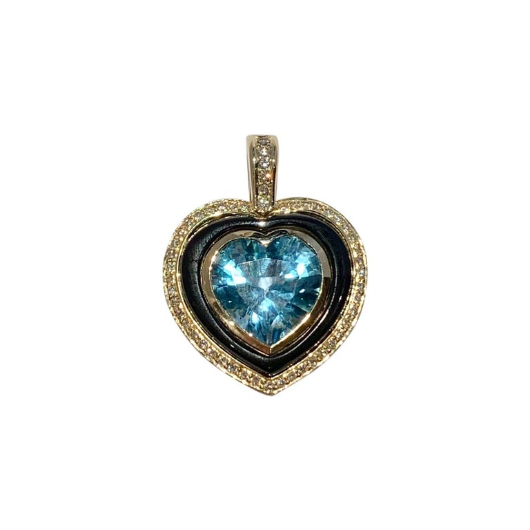 Heart Shaped 10 Carat Blue Topaz Onyx and Diamond Pendant in 9 Carat Yellow Gold For Sale