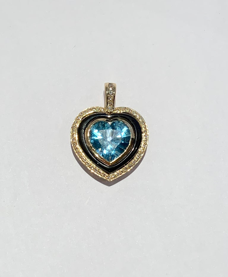 This truly is a unique and elegant pendant and would make a great talking point.  The Heart Shaped 10ct Swiss Blue Topaz is a medium blue with wonderful clarity and measures 15.5 x 13.5 approximately.  The Topaz is bezel set in a 9ct Yellow Gold