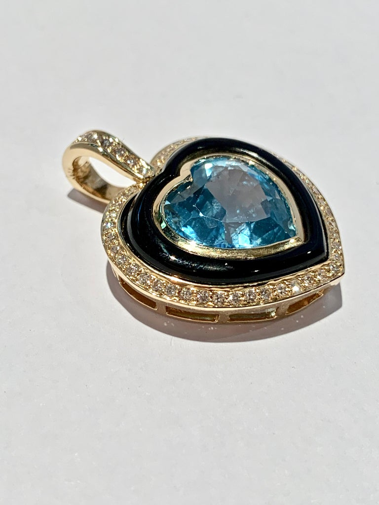 Modern Heart Shaped 10 Carat Blue Topaz Onyx and Diamond Pendant in 9 Carat Yellow Gold For Sale