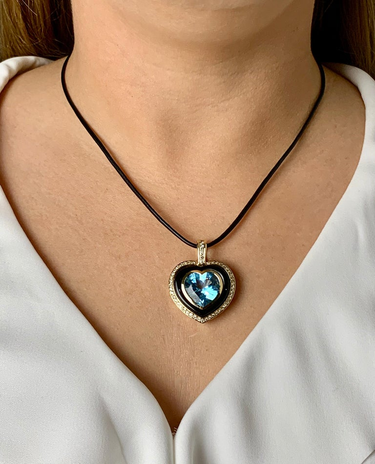 Women's Heart Shaped 10 Carat Blue Topaz Onyx and Diamond Pendant in 9 Carat Yellow Gold For Sale