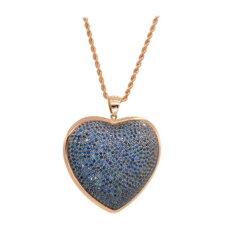 Heart Shaped Pendant in Blue Sapphires Pave and 18 Karat Pink Gold For Sale