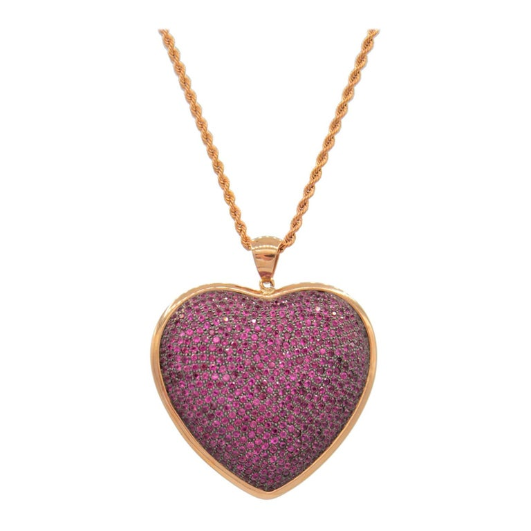 Heart Shaped Pendant in Rubies Pave and 18 Karat Pink Gold For Sale