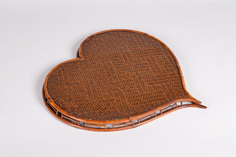 Heart shaped rattan and bamboo tray. Meiji period (1868-1912) woven tray in a highly unusual shape for a tray. Beautiful patina.