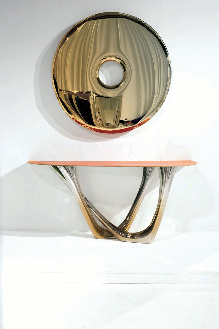 Limited edition mirror in flamed gold polished stainless steel.