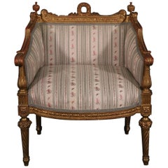 Heavily Carved Gilded French Louis XVI Bergere Chair Circa 1890