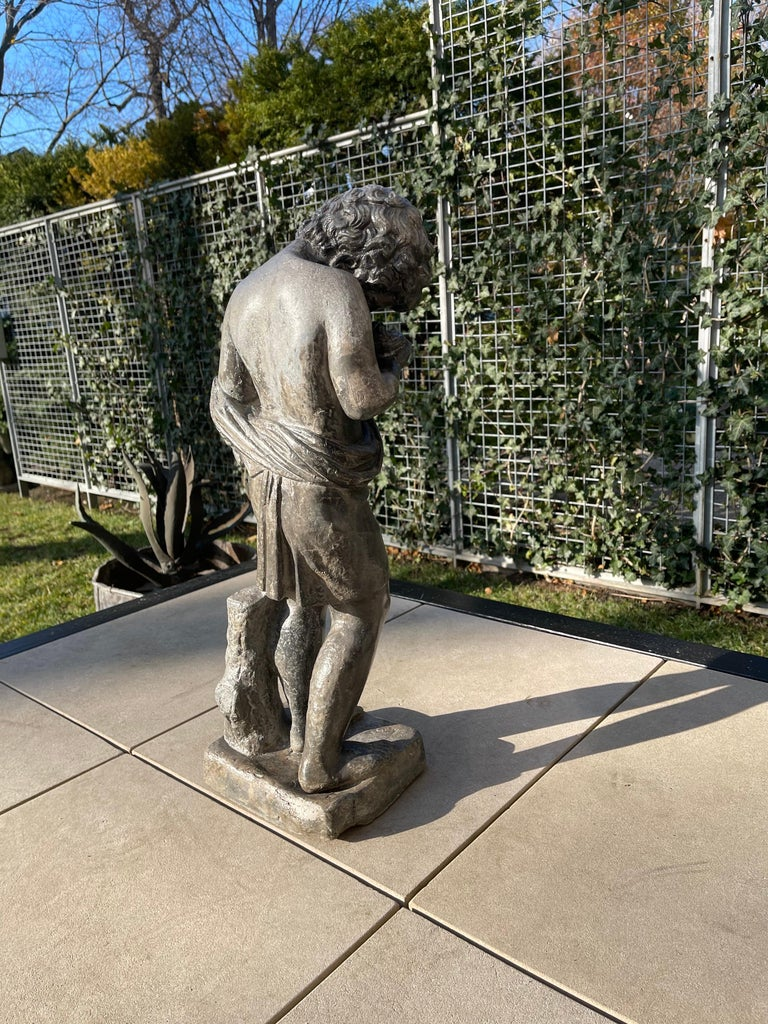 Heavy Lead Figural Statue Depicting a Putto with Bird's Nest, Italy, circa 1880 In Good Condition For Sale In Chicago, IL