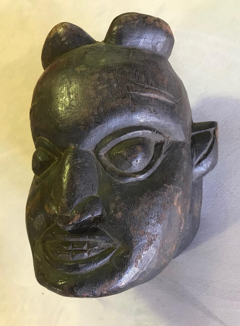 A wonderfully carved, heavy tribal mask. The mask is from the collection of famed American writer Gore Vidal who was an avid collector of tribal masks and artifacts. It was listed as being from Papua New Guinea but could be from another region.