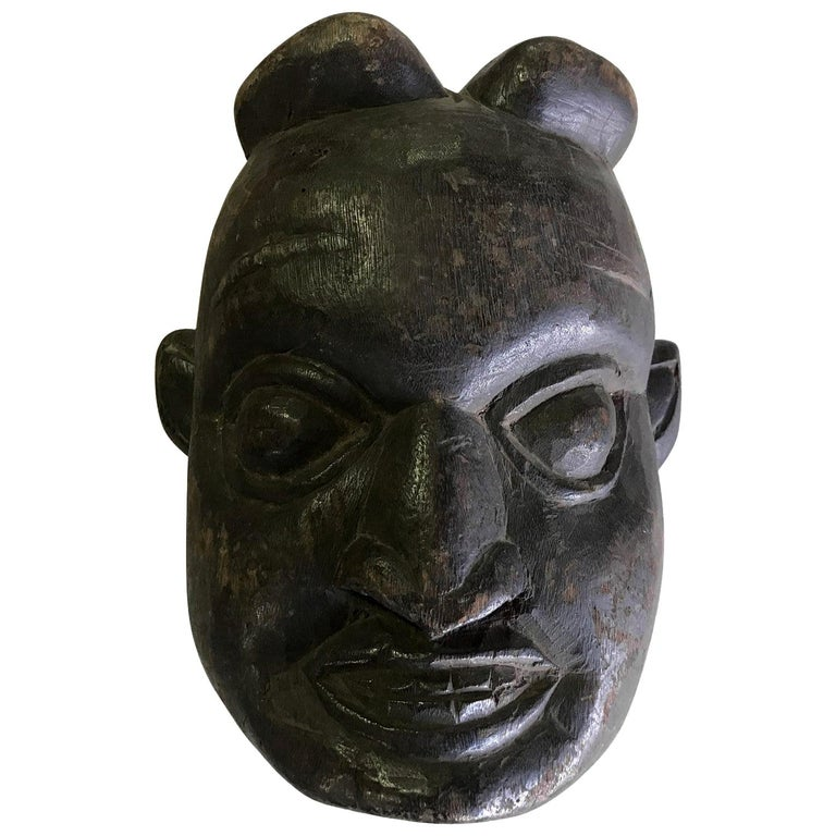 Heavy Oceanic Papua New Guinea or African Carved Wood Mask For Sale