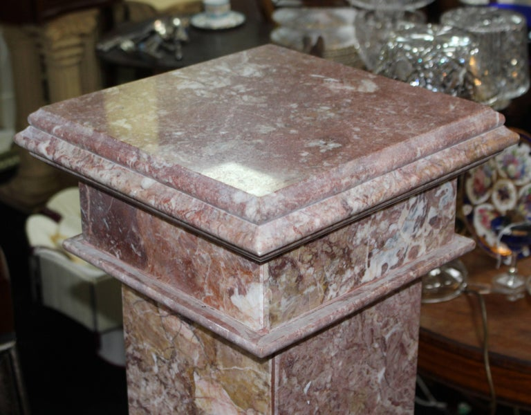 Period:  Mid-late 20th century  Composition:  Marble  Condition:  Very good condition commensurate with age, small nibble to marble near base.     Heavy rouge marble pedestal  Splits into three; top, column and base.
