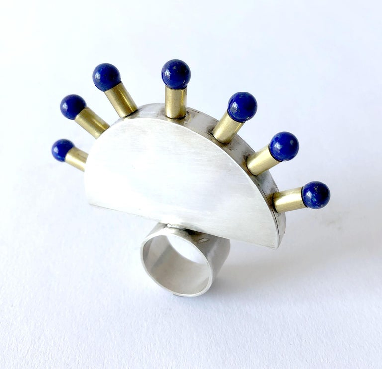 Large scale sterling silver and brass ring accented with seven lapis lazuli spheres.  Entitled