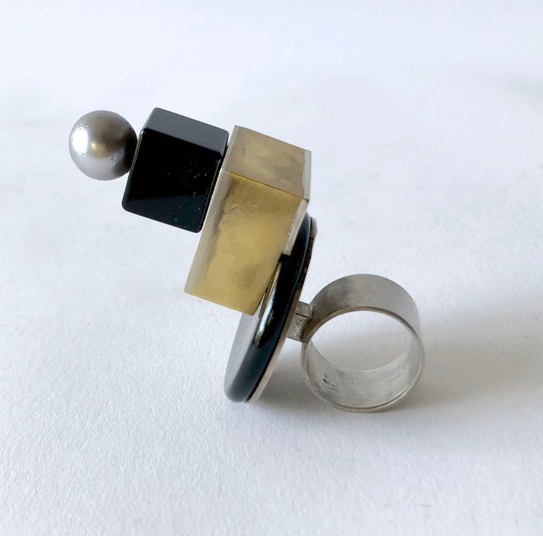 Sterling silver and brass architectural ring with onyx disc and cube, topped off by a Tahitian pearl created by Heidi Abrahamson of Phoenix, Arizona. Ring is a finger size 7.75 - 8 and stands 2