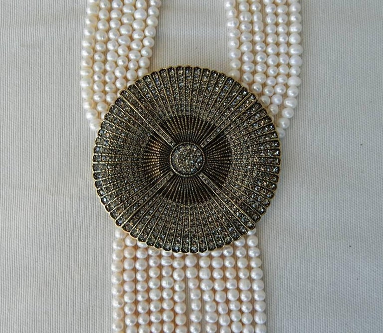 Exquisite statement Heidi Daus iconic Belgian Disc necklace new in box.   The iconic disc is known in her collection.  However, this drop necklace is constructed of pure white authentic cultured freshwater pearls.  Most versions of this necklace do
