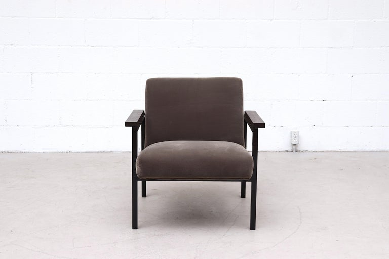 Hein Stolle attributed lounge chair with newly upholstered charcoal velvet on a black enameled metal frame with lightly refinished dark wenge arm rests. In good overall condition with original frame.