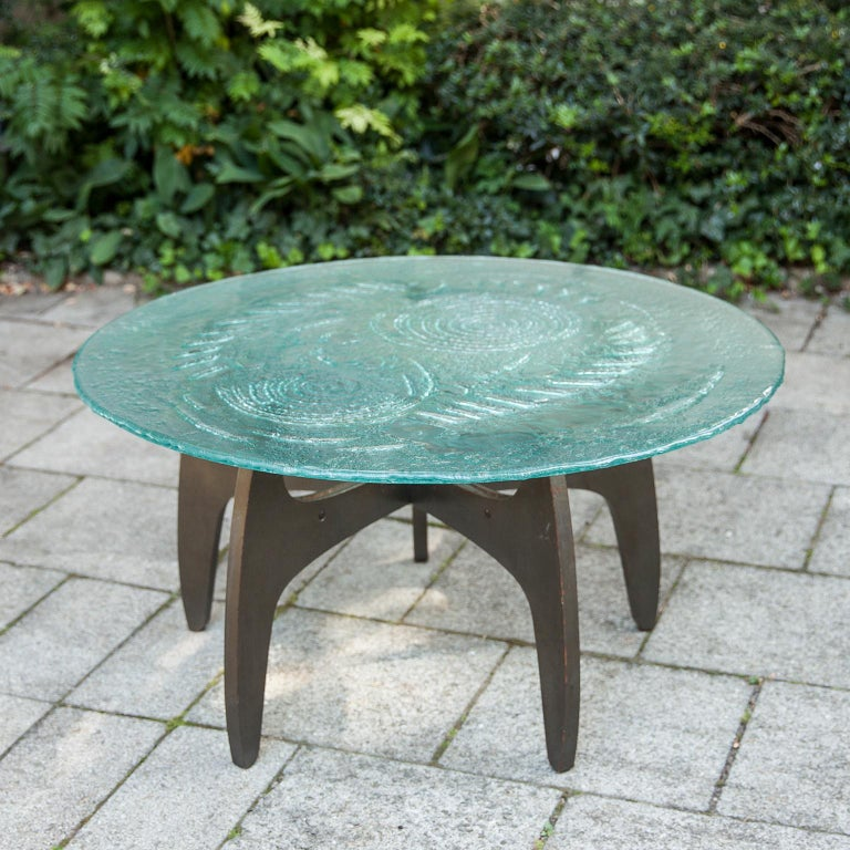 Wonderful glass top work coffee table based on a 5 star wood base designed by the German artist Heinz Lilienthal, in the 1960s.