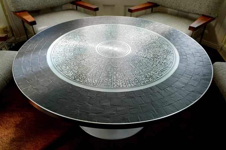 Important and very rare coffee table by German Sculptor Heinz Lilienthal, 1927-2006. The etched stainless- steel-plate of the tabletop with the archaic but timeless pattern is exemplary for the talent of this Artist. Stainless steel and Slate
